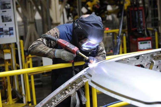 DEARBORN, MI., Nov 11, 2014--Clark Barton helps build the all new 2015 Ford F150 at Ford Motor Company's Dearborn Truck Plant. Photo by: Sam VarnHagen/Ford